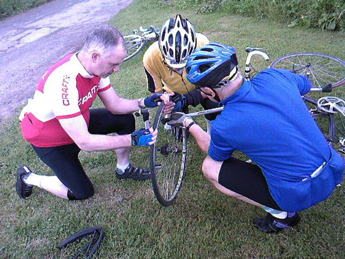 Never go cycling without a team of helpful mechanics